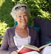 Senior Reading Outside - Oakmont at Gordon Park | Bristol, VA